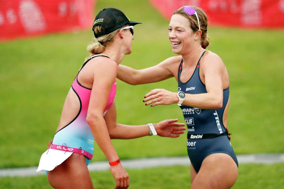 Winner Emma Pallant-Browne (left) congratulates second-place finisher Holly Lawrence at the finish line.