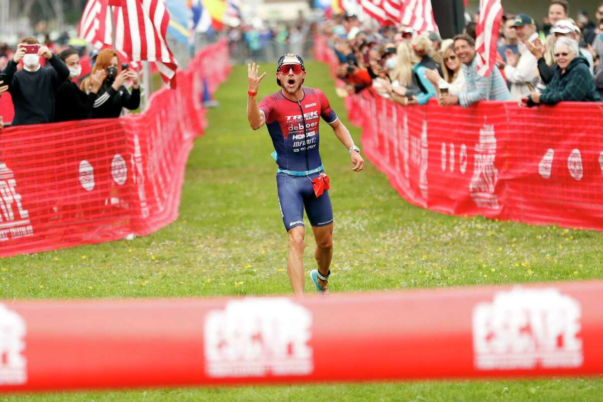 Ben Kanute starts to celebrate his fourth straight win of the Escape from Alcatraz Triathlon as he approaches the finish line.