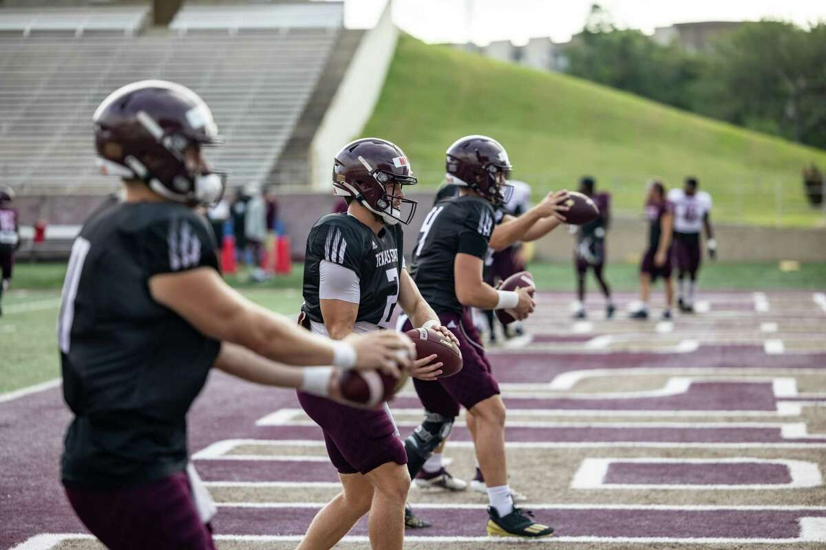 Texas State Quarterbacks Tyler Vitt (11), left, Brady McBride (2), center, and Ty Evans (4), right, warm up for an inter-squad scrimmage on Saturday, August 14, 2021, in San Marcos, TX. (Jordan Vonderhaar/Contributor)