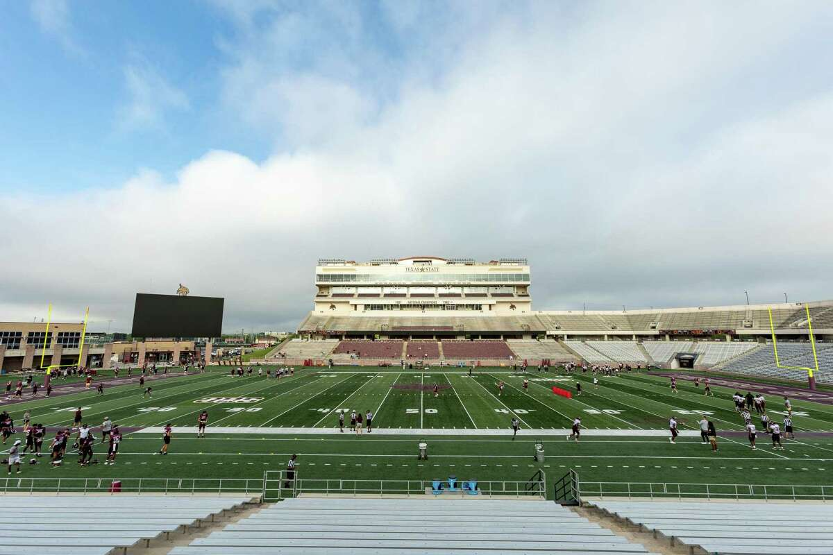 Texas State University's football team warms up for an inter-squad scrimmage on Saturday, August 14, 2021, in San Marcos, TX. (Jordan Vonderhaar/Contributor)