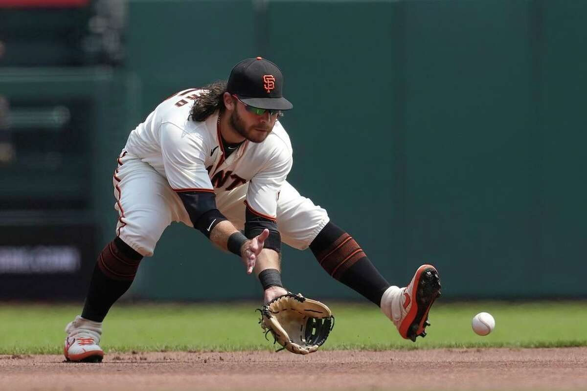 San Francisco Giants shortstop Brandon Crawford fields a groundout hit by Colorado Rockies' Connor Joe during the first inning of a baseball game in San Francisco, Sunday, Aug. 15, 2021. (AP Photo/Jeff Chiu)