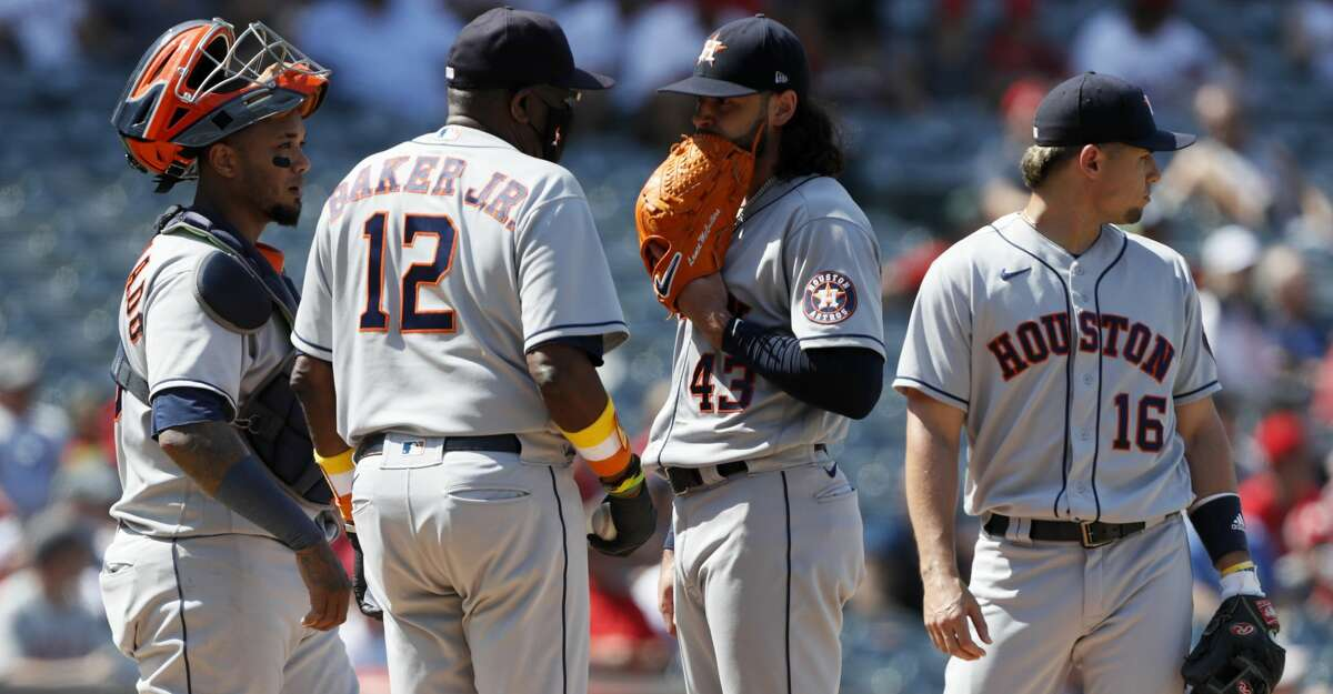 Houston Astros manager Dusty Baker Jr., second from left, pulls starting pitcher Lance McCullers Jr. (43) with catcher Martin Maldonado, left, and third baseman Aledmys Diaz, right, at the mound during the sixth inning of a baseball game against the Los Angeles Angels in Anaheim, Calif., Sunday, Aug. 15, 2021. (AP Photo/Alex Gallardo)