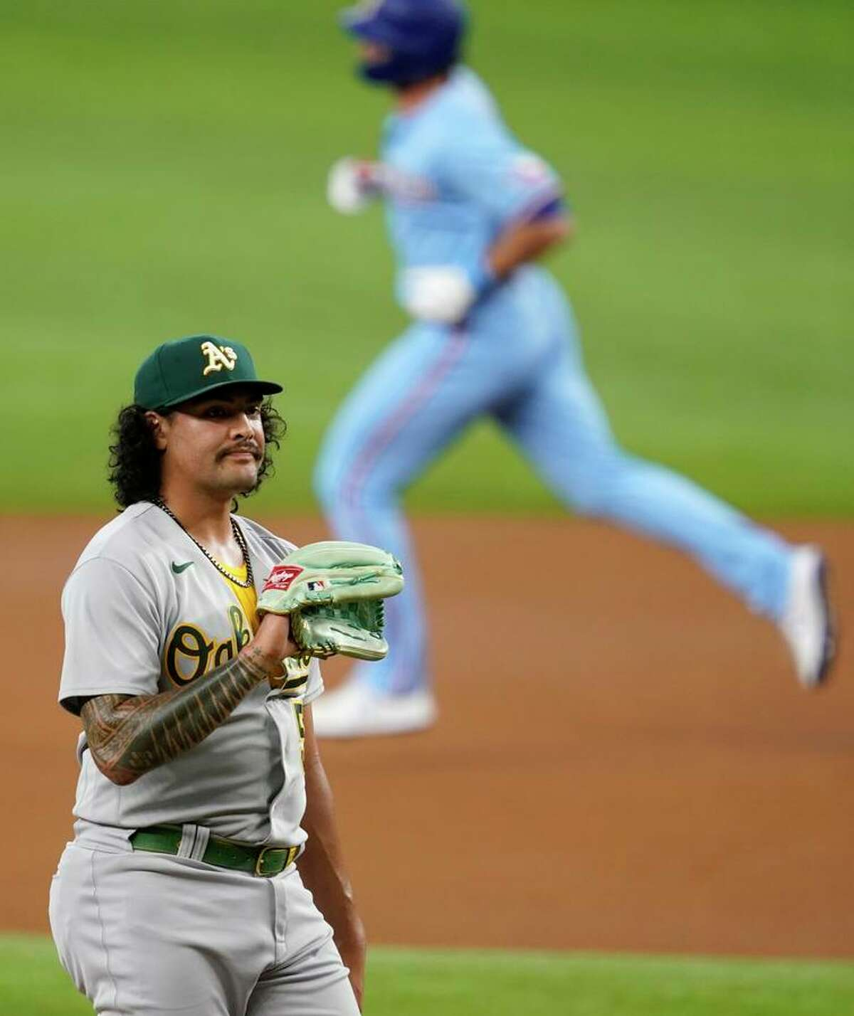 Sean Manaea waits for a new baseball as DJ Peters circles the bases after homering in the first.