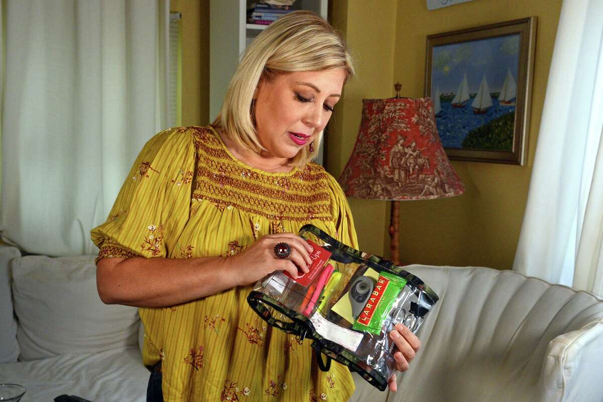 Sharon Lynn holds a sample of one of her Glam Roll-Ups products during an interview at her home in Milford.