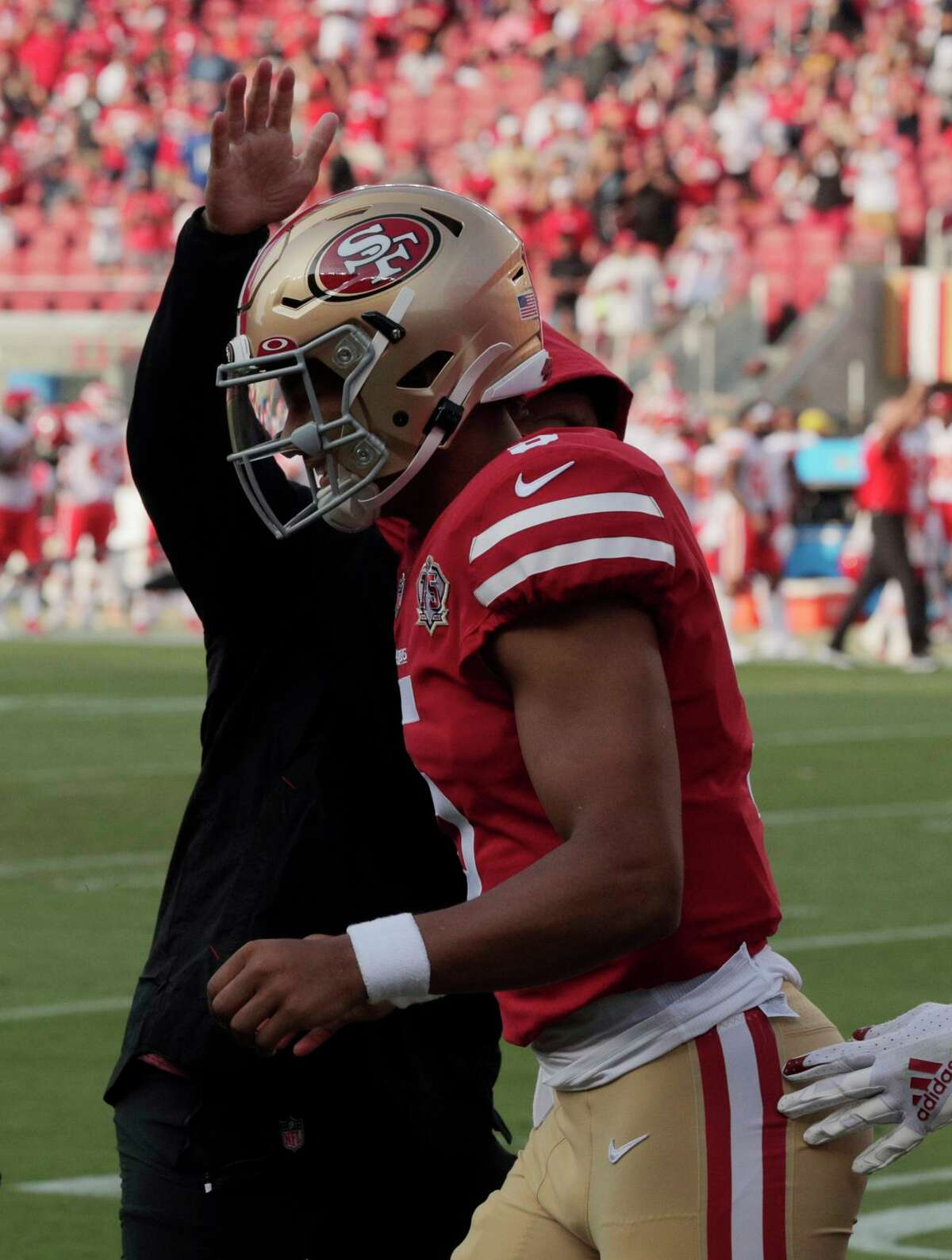 Trey Lance (5) congratulated by teammates after his touchdown pass to Trent Sherfield in the first half as the San Francisco 49ers played the Kansas City Chiefs at Levi's Stadium in Santa Clara, Calif., on Saturday, August 14, 2021.