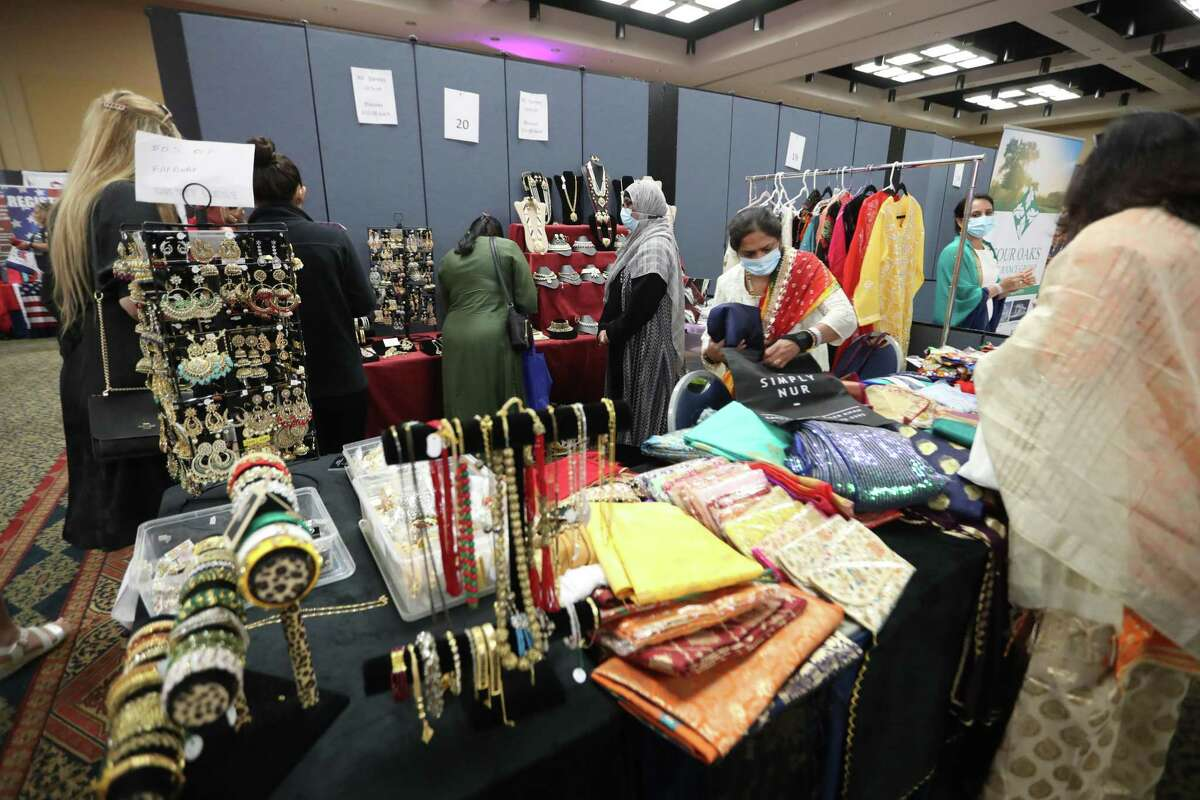 A vendor sells clothes and jewelry in a booth during the India Culture Center's 75th Independence Day of India Celebration at the Stafford Centre, Sunday, August 15, 2021, in Stafford.