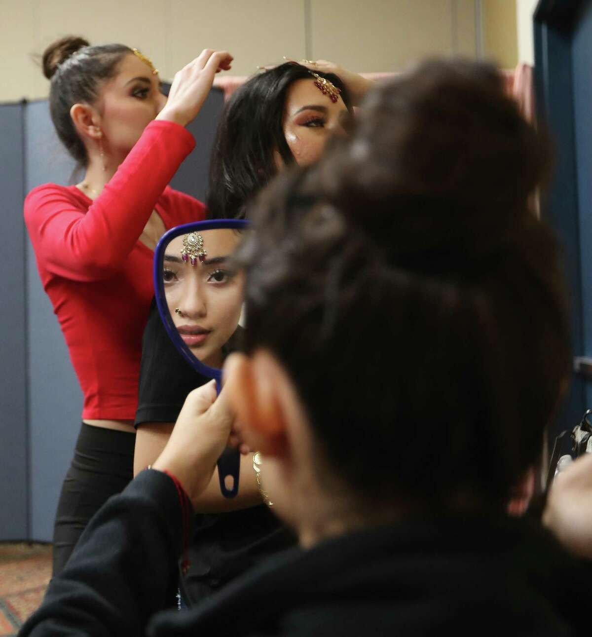 """Jocelyn Perales, 18, prepares to go on stage with other members of the Mis Belleza Mexico USA"""" group during the India Culture Center's 75th Independence Day of India Celebration at the Stafford Centre, Sunday, August 15, 2021, in Stafford."""