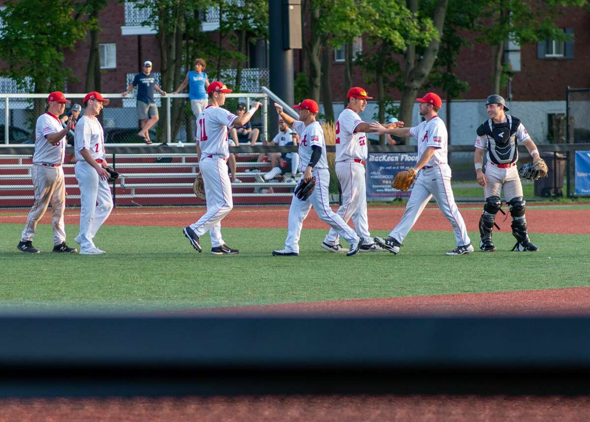 The Albany Athletics share high-fives after finishing an historic 2021 season as runners-up at the AABC Stan Musial Northeast World Series in Weymouth, Mass. on Sunday, Aug. 15, 2021.