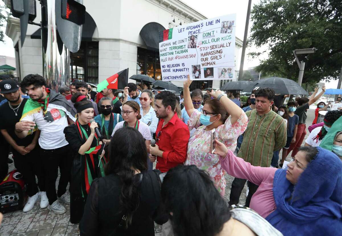 Members of Afghan Community Houston protest at the corner of Post Oak and Westheimer, Sunday, August 15, 2021, in Houston.