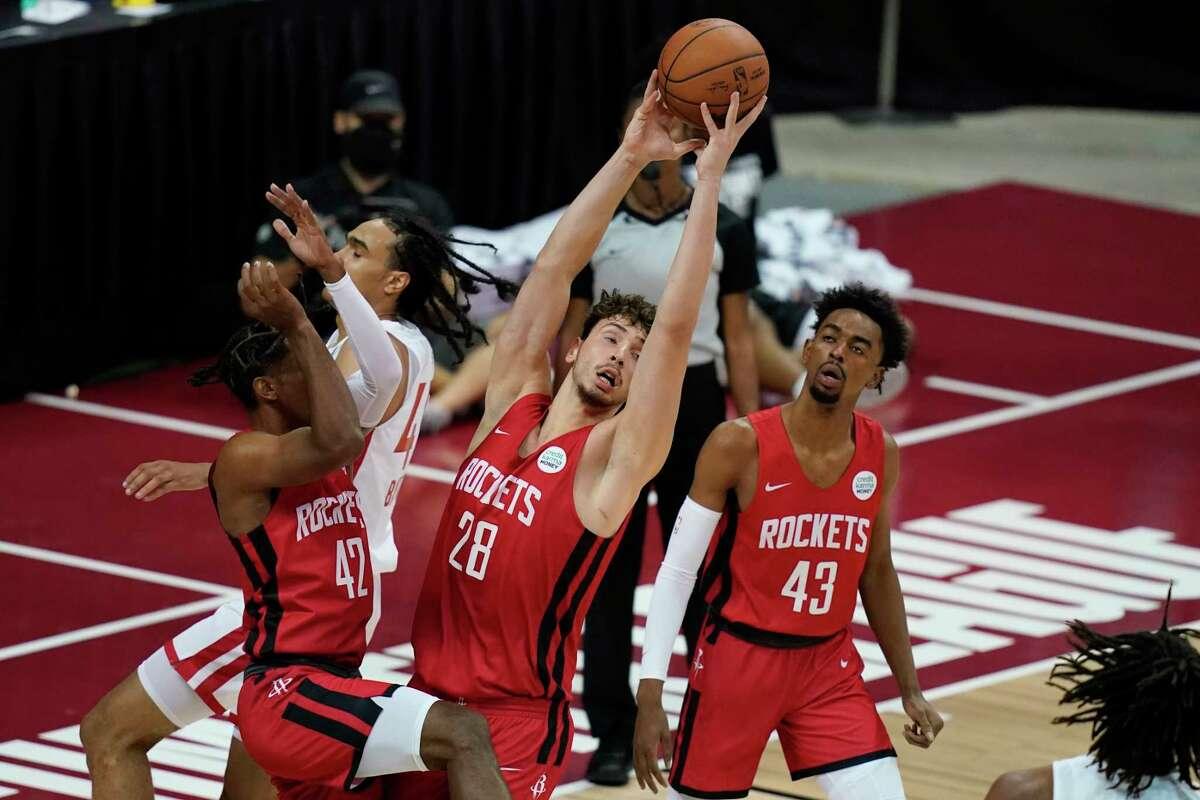 Houston Rockets' Alperen Sengun grabs a rebound against the Toronto Raptors during the second half of an NBA summer league basketball game Thursday, Aug. 12, 2021, in Las Vegas. (AP Photo/John Locher)
