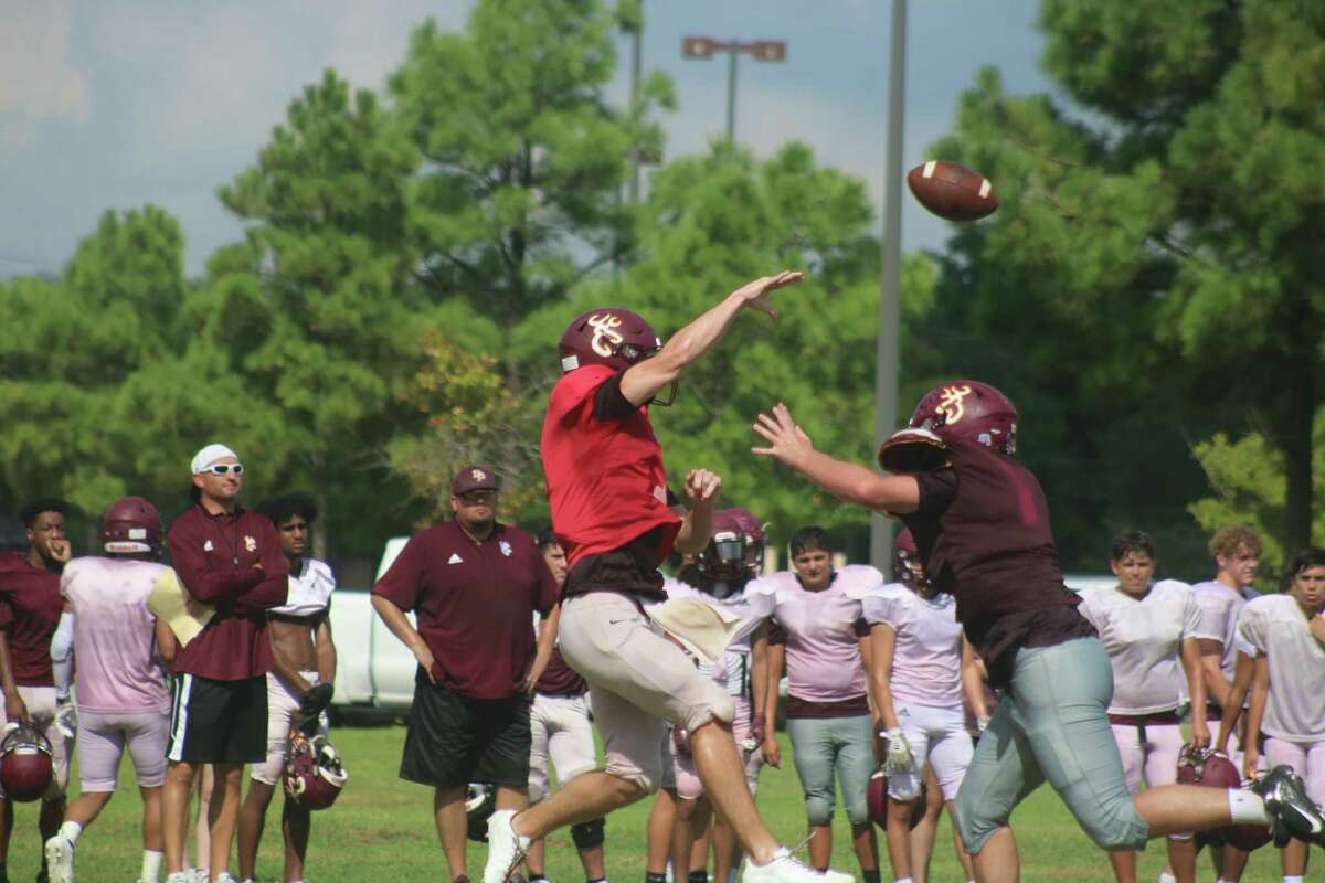 Heavy pressure forces Deer Park quarterback Teague Sedtal to dump off a pass during Saturday's first day in pads.