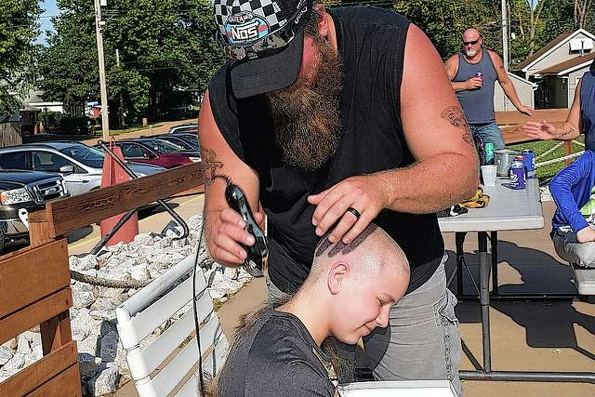 His hair was cut from a mullet to a bald head.