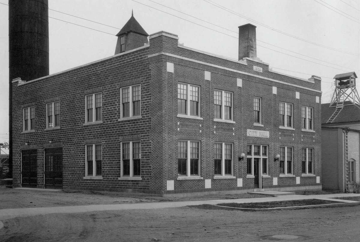 This photo from 1926 shows the then brand new Bad Axe City Hall, complete with garage doors to house fire trucks. Instead of a siren that went off during the day, it had a whistle, which was mainly used to call firefighters into action before being used to denote certain times of the day. (Bad Axe Historical Society/Courtesy Photo)