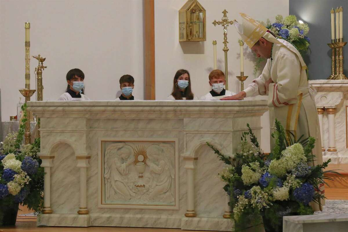 Bishop Frank Caggiano anoints the new altar at Our Lady of Fatima Roman Catholic Church on Sunday, Aug. 15, 2021.