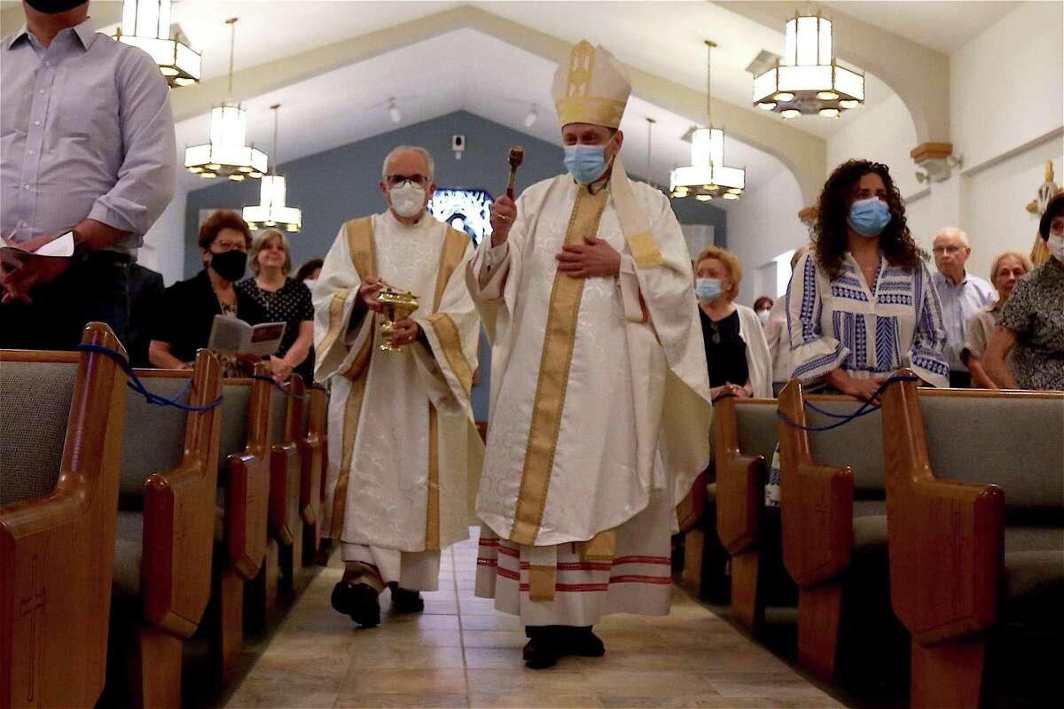 Bishop Frank Caggiano circles the congregation.