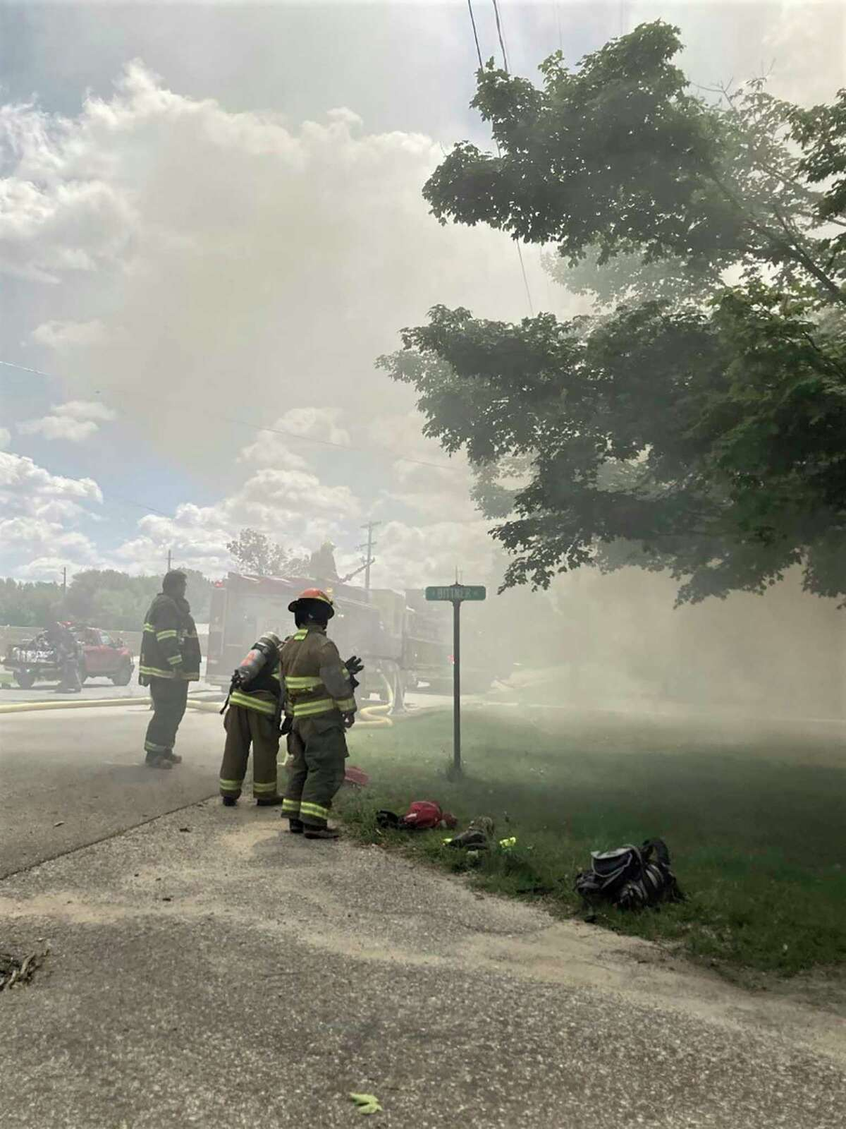 First responders work to put out a house fire Saturday, Aug. 14, on the 400 block of East Bittner Avenue in Reed City. (Photos courtesy of Miguel Troche)