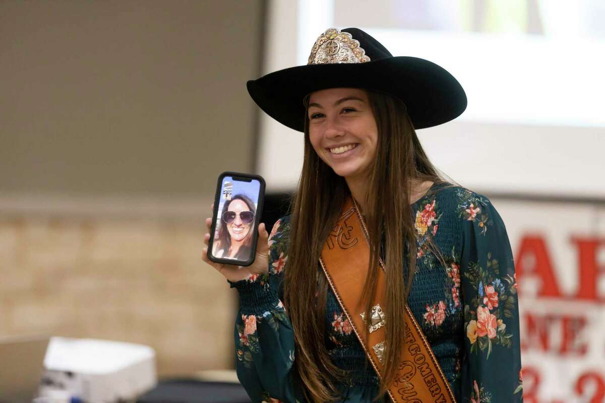 Morgan McGee, 2021 Montgomery County Fair Queen, shares a livestream with Melissa Reagan after Reagan was announced 2020 Chairperson of the Year during The Montgomery County Fair Association annual Awards Dinner at the Lone Star Convention Center, Saturday, Aug. 14, 2021, in Conroe.