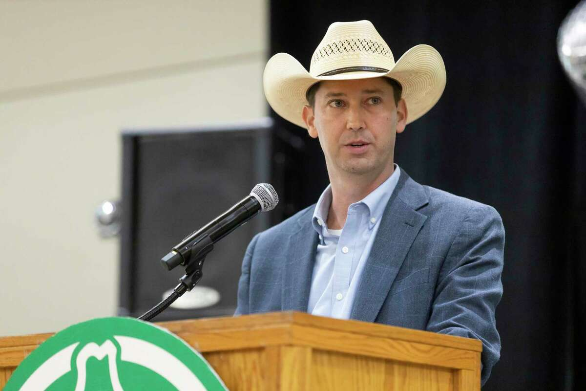 Montgomery County Fair Association Executive Committee President Cody Bartlett speaks during The Montgomery County Fair Association annual Awards Dinner at the Lone Star Convention Center, Saturday, Aug. 14, 2021, in Conroe.