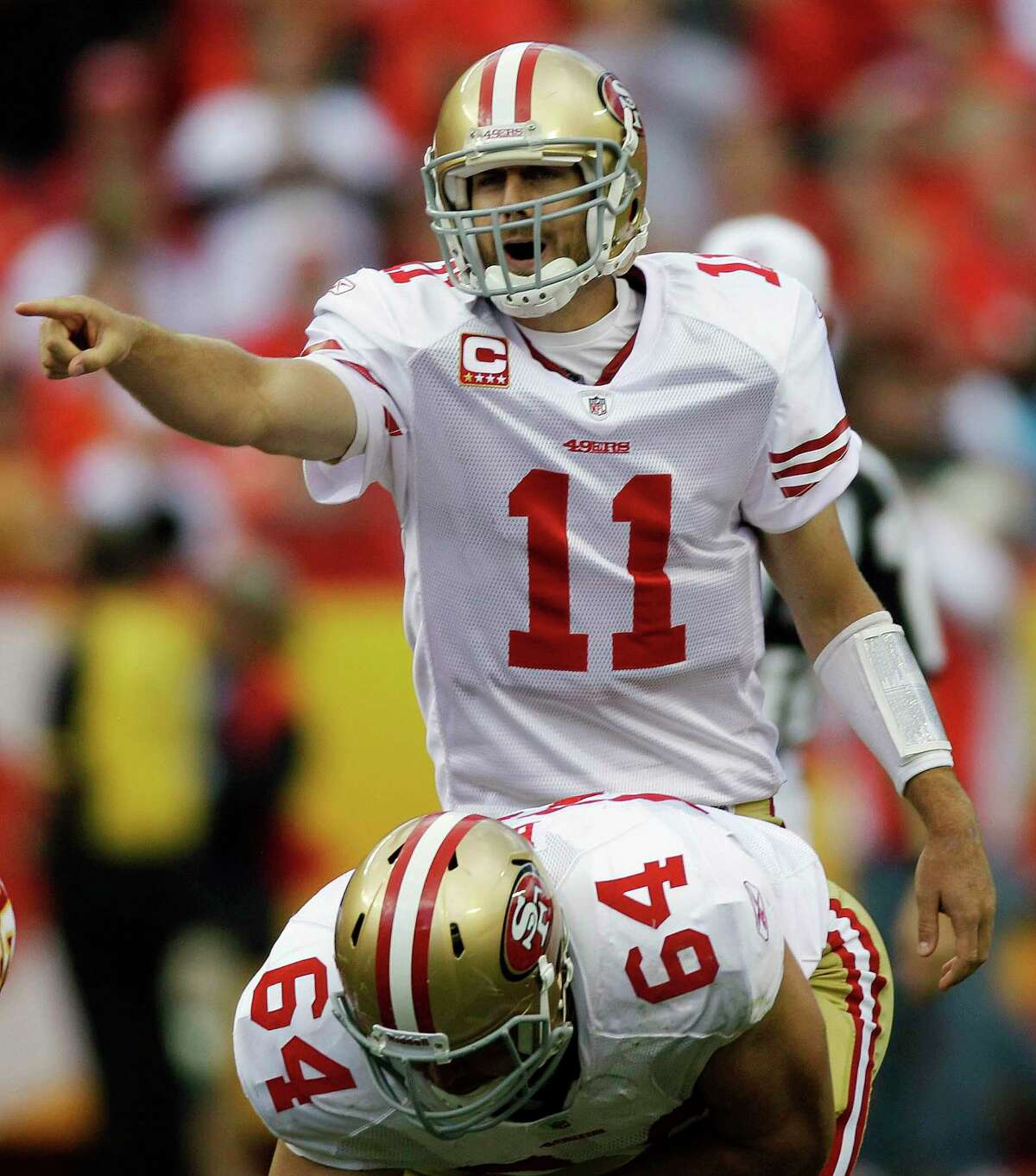 FILE - In this Sept. 26, 2010 file photo, San Francisco 49ers quarterback Alex Smith (11) gestures during the first half of an NFL football game against the Kansas City Chiefs in Kansas City, Mo. Smith is headed to Kansas City, the first major acquisition by the Chiefs since Andy Reid took over as coach. A person with knowledge of the trade told The Associated Press on Wednesday, Feb. 27, 2013, that the Chiefs have agreed to deal for the 2005 top overall draft pick who lost his starting quarterback job in San Francisco to Colin Kaepernick last season. The person spoke on condition of anonymity because the trade does not become official until March 12, when the NFL's new business year begins. (AP Photo/Orlin Wagner)