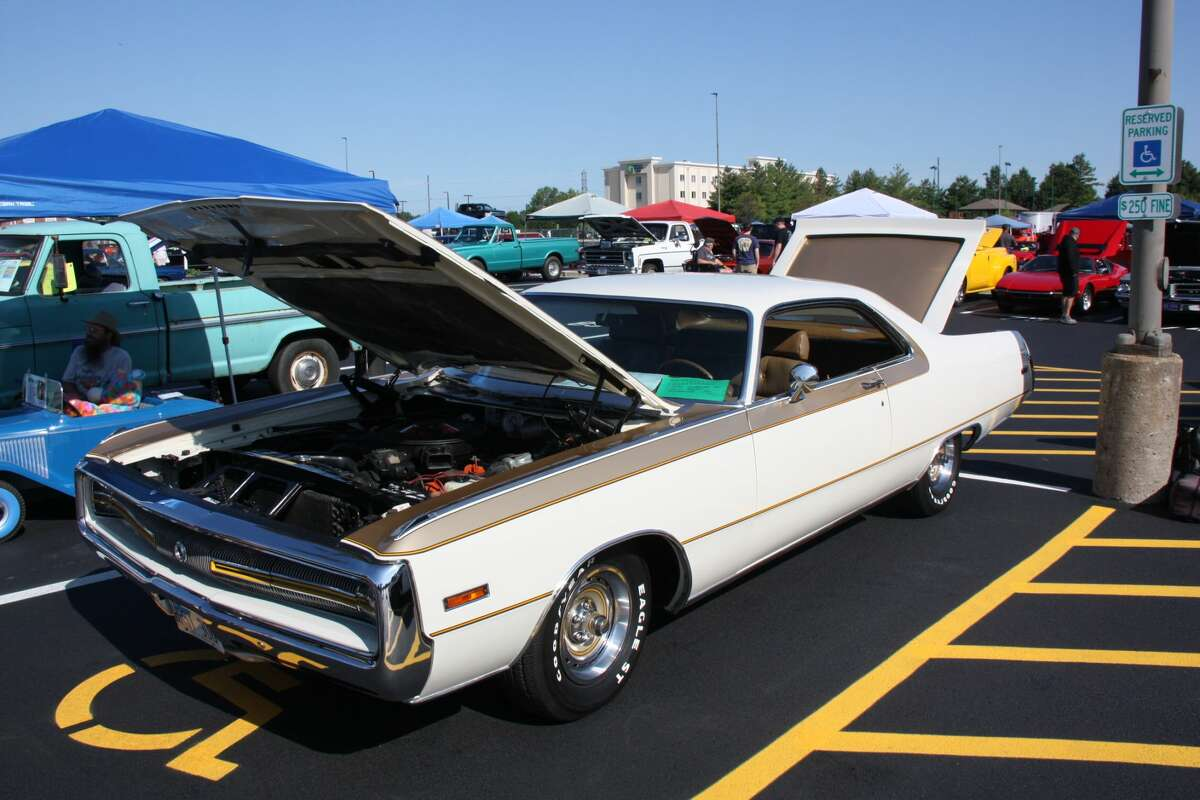 """This 1970 Chrysler 300 is owned by Seth Renken of Edwardsville. It is dressed in Spinnaker White and Satin Tan with a leather interior borrowed from the Imperial. Under the hood is a 7.2L V-8 making 375 horsepower. It was one of about 500 examples made in cooperation with Hurst Performance and displays Chrysler's """"fuselage"""" styling that debuted the year before."""