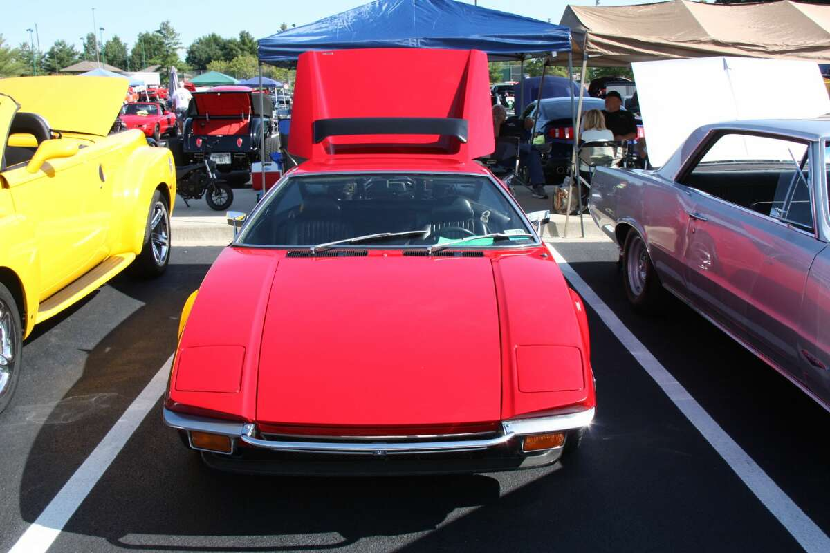 This is a 1971 DeTomaso Pantera, owned by Brian M. of Marine. It is one of 1,007 examples exported to the US that year, the debut of an Italian-American collaboration with Ford. The cars were sold through Lincoln-Mercury dealers. In return for DeTomaso's head-turning styling and cabin equipment, the car was powered by Ford's 302 CID V-8. In 1972, Ford switched to the 351 CID V-8.