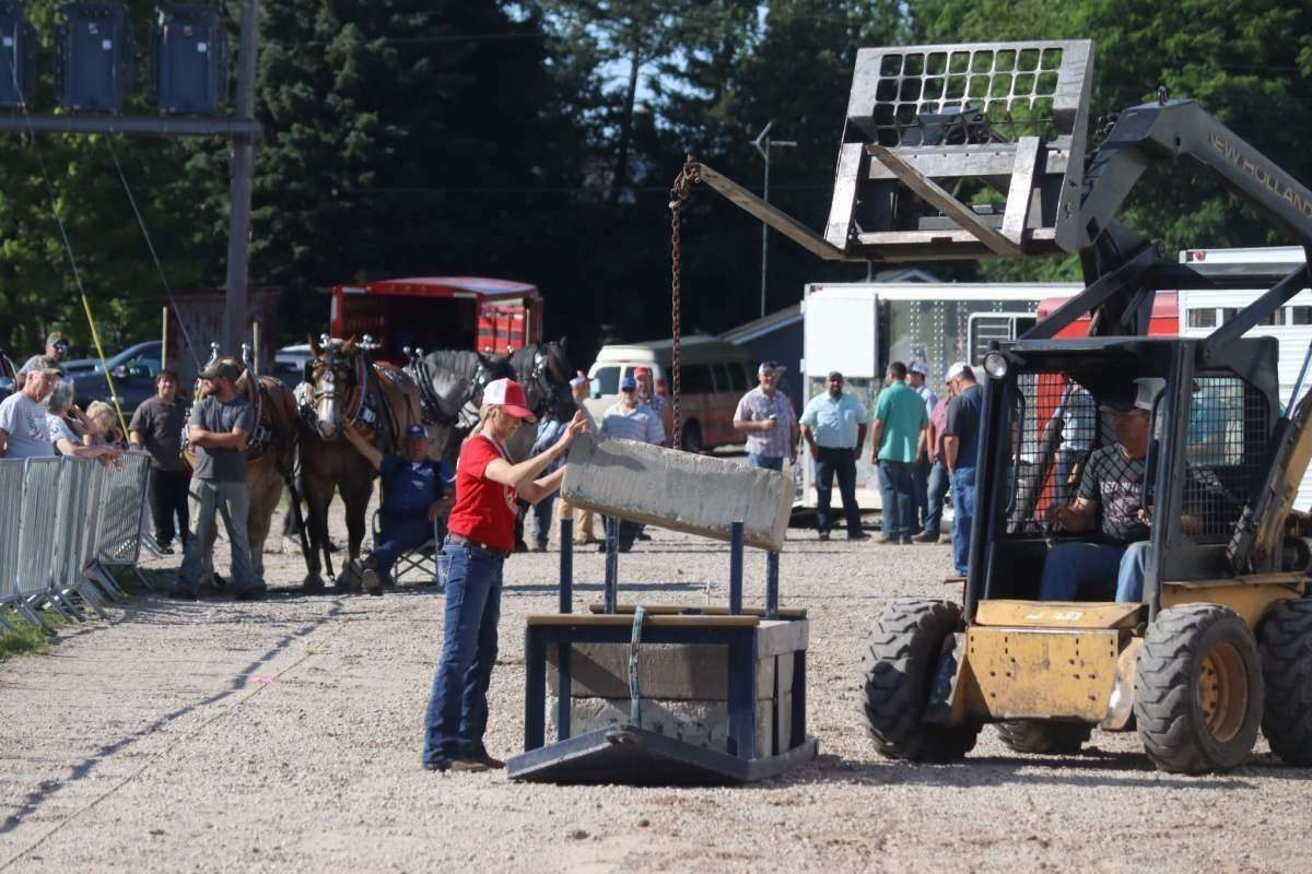 File - During the heritage horse pull competition, the only requirement is a team must pull the load 27.5 feet on a continuous pull to qualify for the next load.