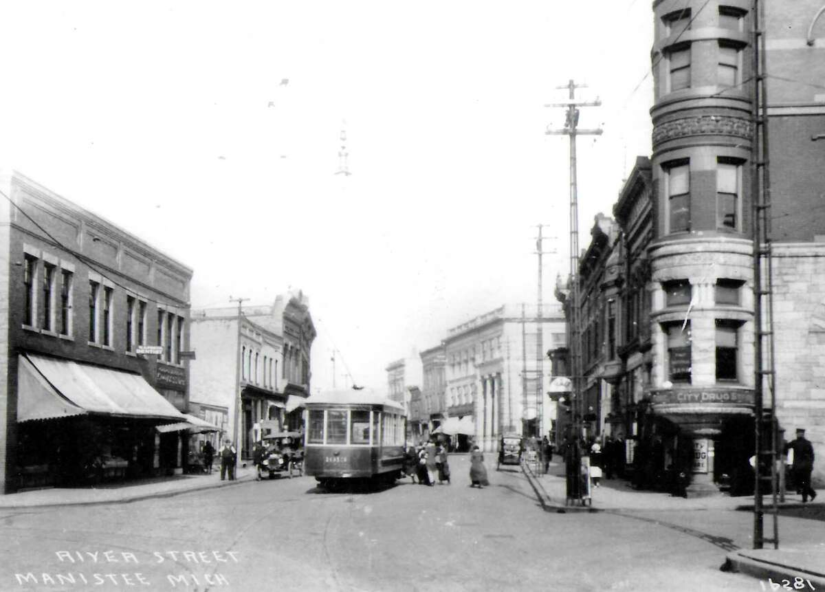 It was announced during this week in 1921 that the Manistee Railway Company announced that curtailed service would continue within the city. This photo shows the street railway car near the corner of River and Maple streets.(Manistee County Historical Museum photo)
