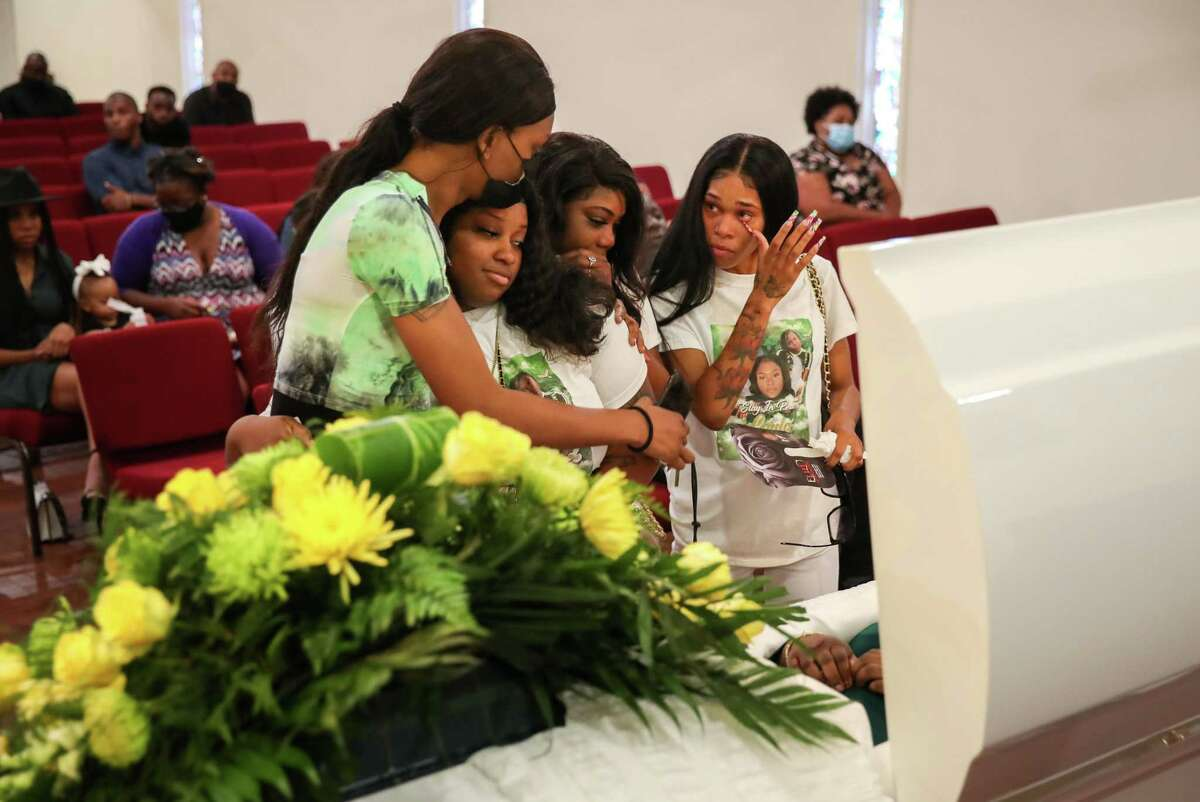 Brielle McCray, left, Tarsha Mosley, Alexus Ward and Autumn Ramey mourn Layla Steele, who police say was killed by her ex-boyfriend.