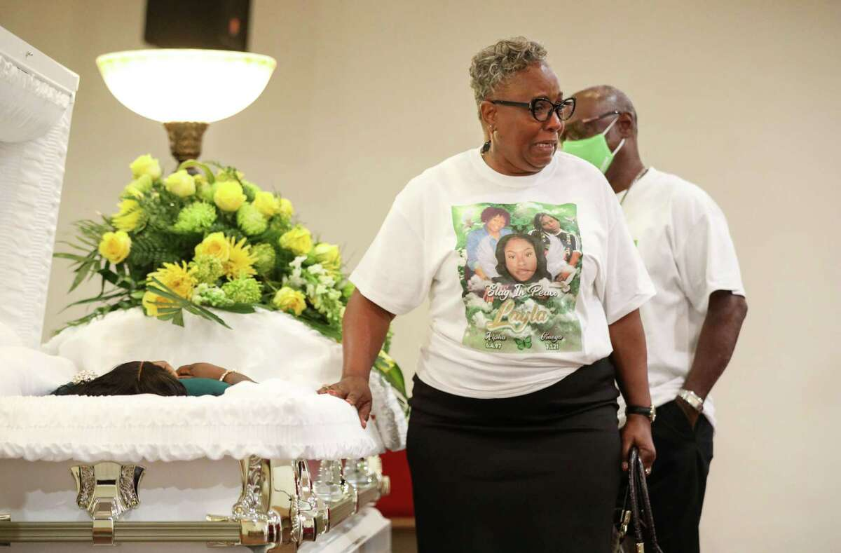 """""""That's my baby, that's my baby,"""" screams Gwendolyn Steele-Jackson as she looks at the body of her niece Layla Steele on Thursday, July 15, 2021, at a celebration of life in Houston. """"It was like seeing my mother's garden,"""" she said. """"It looked like one of her beautiful flowers was taken out of her garden."""""""