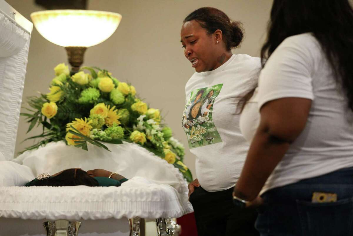 Briah Garey reacts as she sees the body of her sister Layla Steele on Thursday, July 15, 2021, at a celebration of life in Houston.