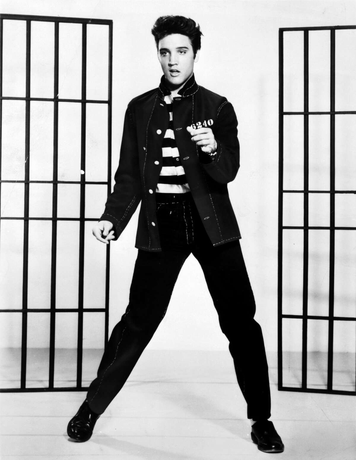 """Elvis Presley:Depending on who you ask, you'll either hear a theory as how the King of Rock 'n' Roll really died, or an even more elaborate explanation as to the theory he's still alive. Both theory angles have multiple reasons. The singer's cause of death by heart attack is often debated in these theories. However, the one that gets passed around the most lies with Elvis' tombstone. A 2017 Time Magazine article points out that Elvis' tombstone has his middle named misspelled. His middle name Aron is spelled with one """"a"""" as opposed to two. No legit name leads those to believe there's no legit death."""
