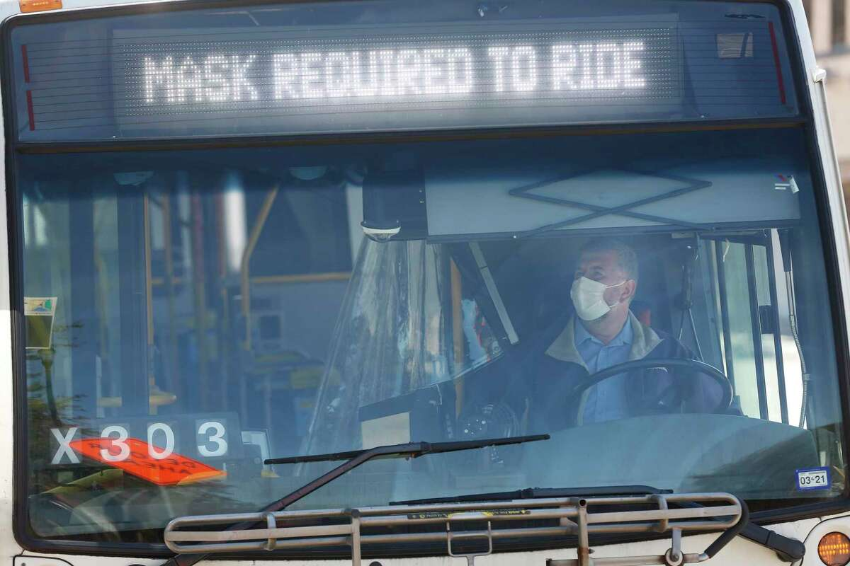 A Metropolitan Transit Authority bus operator waits for passengers at the Wheeler Transit Center on March 3, 2021, in Houston. Riders on all Metro buses and trains are required to wear masks.