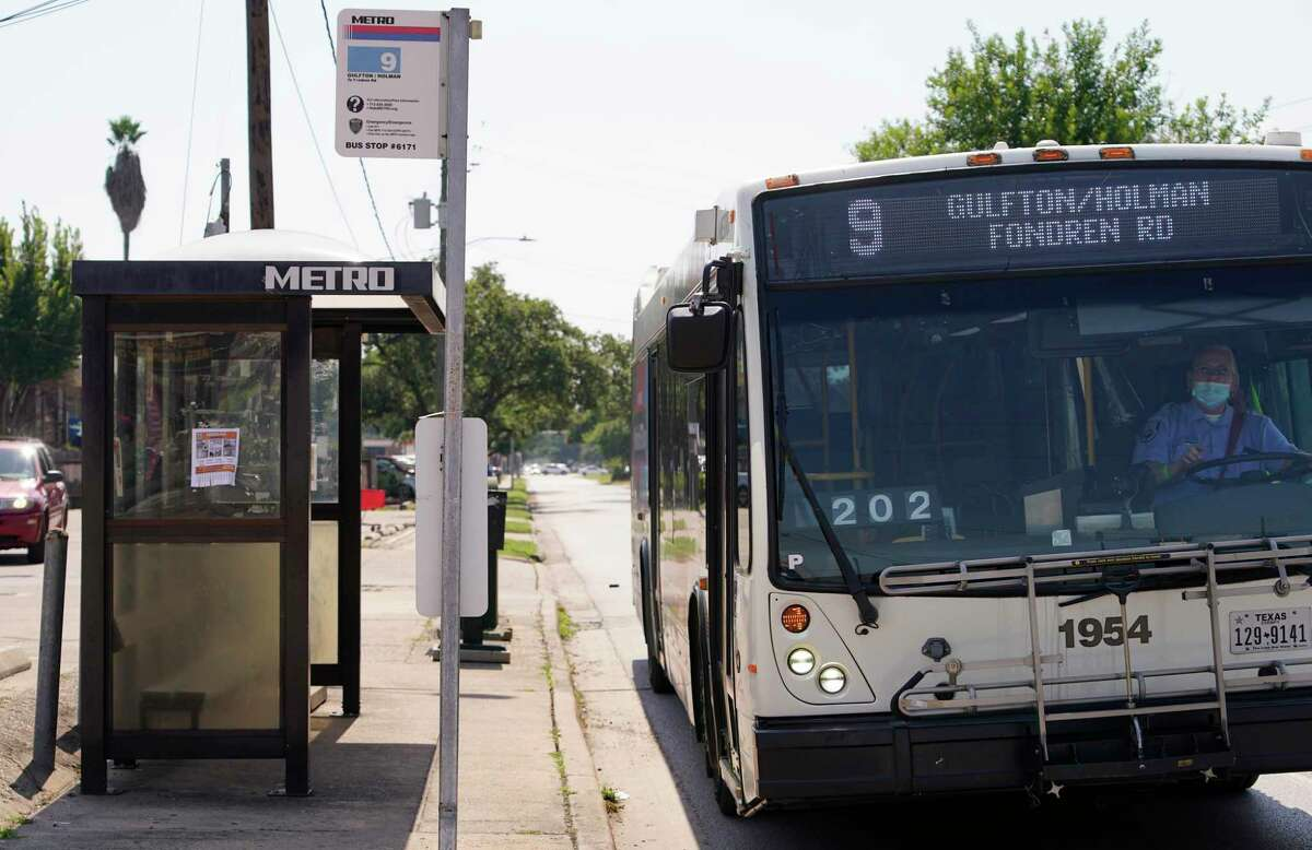 A Metropolitan Transit Authority bus operator leaves a bus stop along Gulfton Street on June 17, 2021 in Houston.