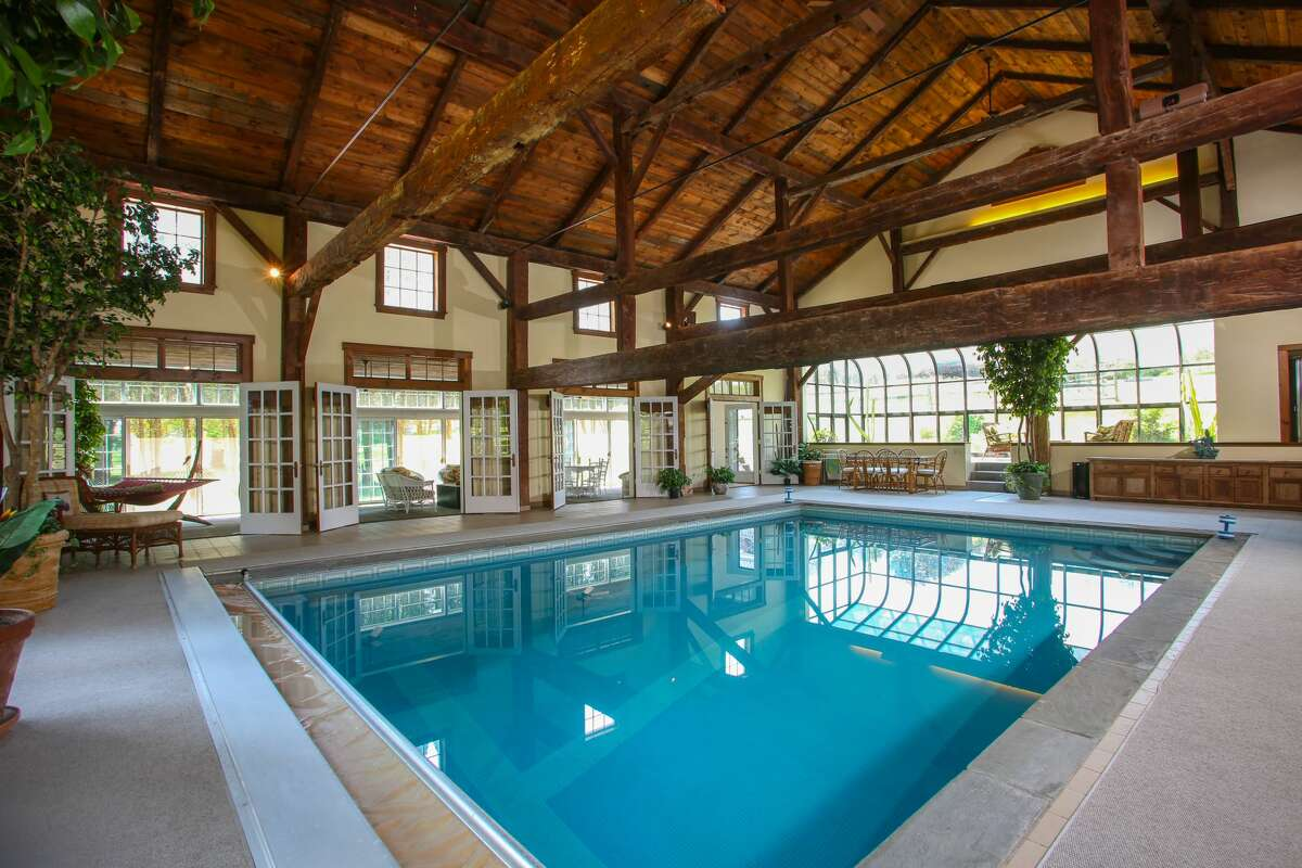 The home on 93 Amenia Union Road in Sharon, Conn. has an indoor pool and spa part of its adjoining residence.