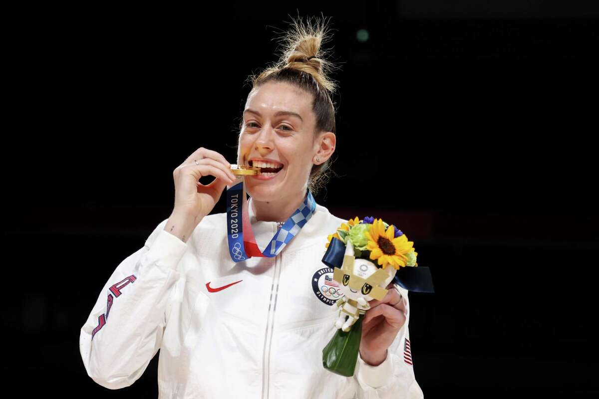 SAITAMA, JAPAN - AUGUST 08: Breanna Stewart #10 of Team United States bites her gold medal during the Women's Basketball medal ceremony on day sixteen of the 2020 Tokyo Olympic games at Saitama Super Arena on August 08, 2021 in Saitama, Japan. (Photo by Gregory Shamus/Getty Images)