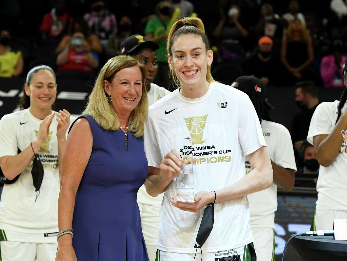 PHOENIX, ARIZONA - AUGUST 12: WNBA Commissioner Cathy Engelbert presents the MVP trophy to Breanna Stewart #30 of the Seattle Storm after a 79-59 win against the Connecticut Sun during the 2021 Commissioner's Cup Championship Game at Footprint Center on August 12, 2021 in Phoenix, Arizona. (Photo by Norm Hall/Getty Images)