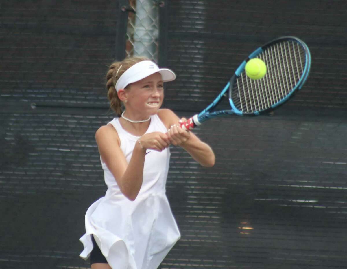 Kendl Kling returns a ball during Saturday afternoon action during the Level 4 Mixed Doubles Tournament at the Deer Park High School courts. Born and raised in Michigan, she's only been a Texas resident for the last seven months.