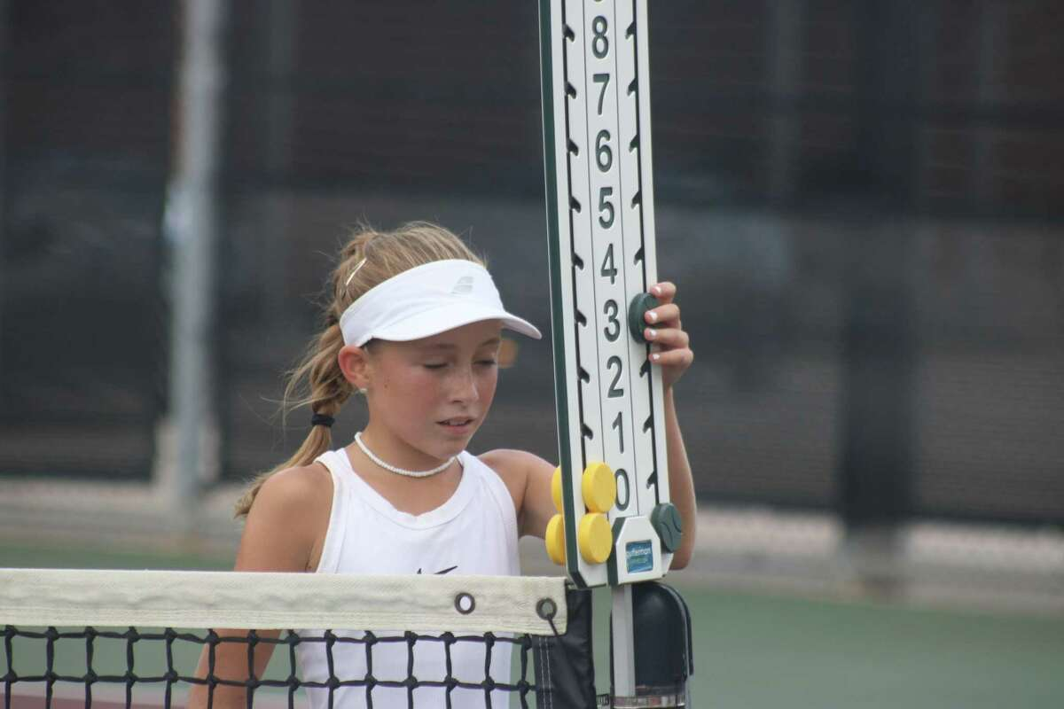 Kendl Kling updates the score during one of the team's matches on Saturday at the Deer Park High School South campus tennis courts.