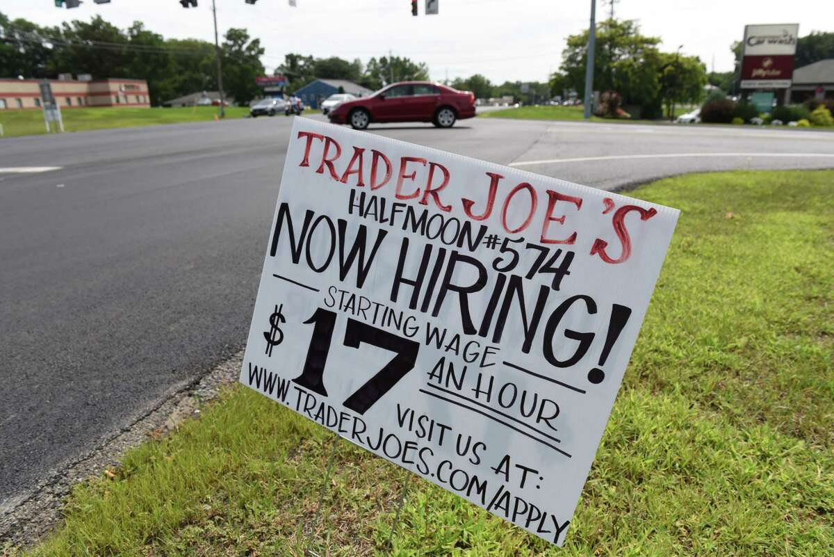 Help wanted signs for the new Trader Joe's supermarket are posted along Route 9 on Monday, Aug. 16, 2021, at Halfmoon Crossing in Halfmoon, N.Y.