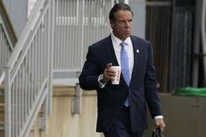 Gov. Andrew Cuomo prepares to board a helicopter after announcing his resignation Aug. 10, 2021.