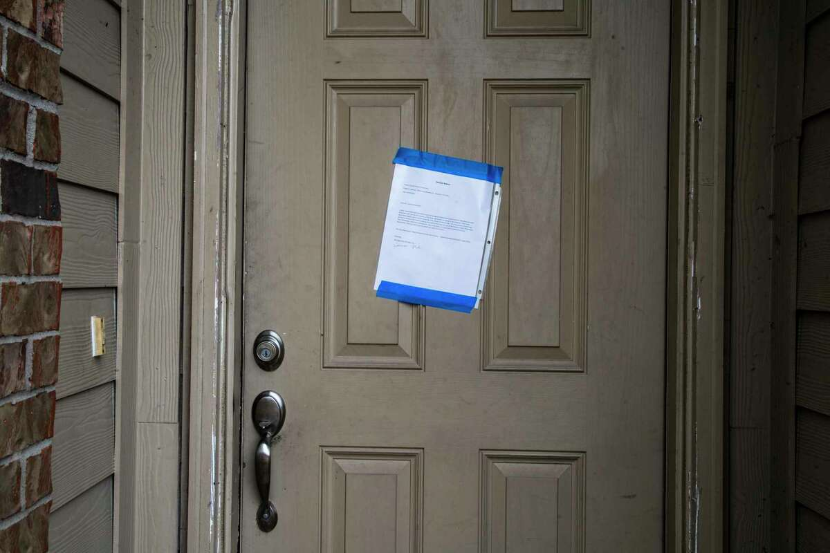 Eviction notice taped on the front door of a property intended for Carroll Shelton Richardson from his landlord Thursday, Sept. 24, 2020, in Houston.