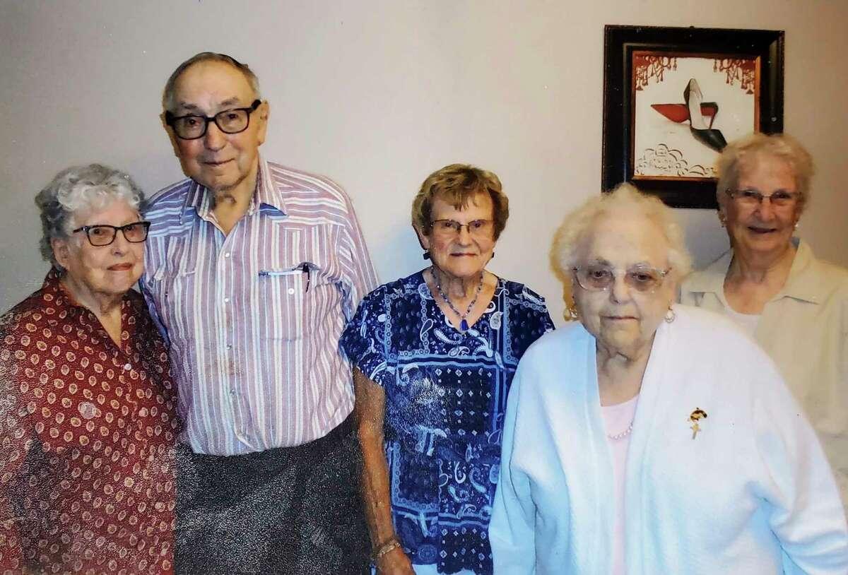 Former classmates Cordelia Trost, Robert Smith, Lorraine Damm Otto, Joyce Hoppe Bannick and Jane Guisbert Rosenthal gather for a photo. (Courtesy Photo)