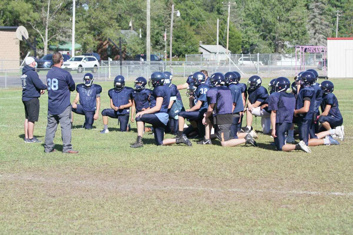 The Brethren High School football team taking a knee at practice. (File Photo)