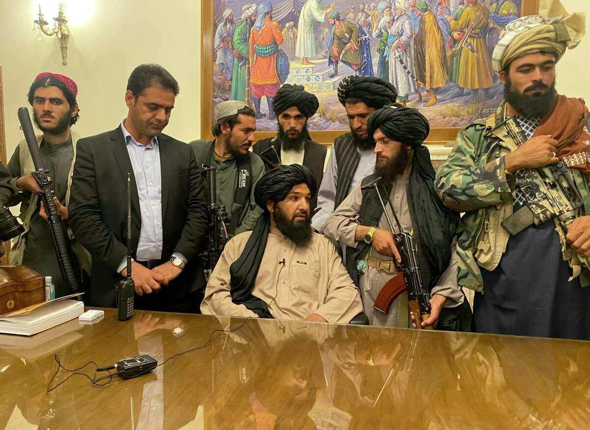 Taliban fighters take control of the presidential palace Sunday after President Ashraf Ghani fled. The sudden end to the war in Afghanistan raises contradictory questions.