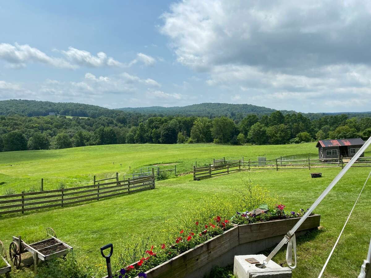 The view across Washington County from the outside dining area at Dancing Ewe Farm in Granville.