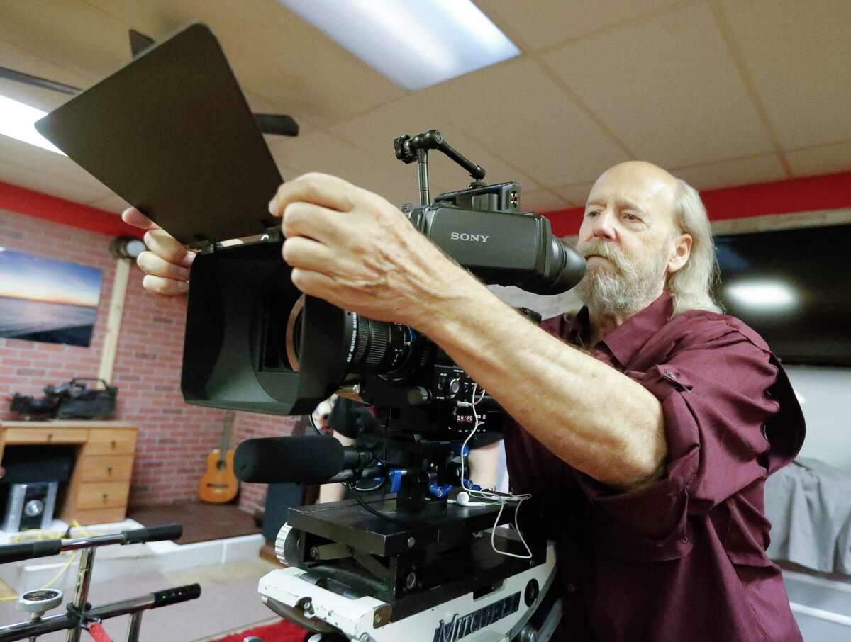 """Film instructor Gary Parker adjusts the camera for film class' first movie """"Escape from Film School"""" at the Indie Film Foundation Studio, Saturday, July 31, 2021, in Conroe. The film premiers at 4 p.m. Saturday at Star Cinema Grill in Conroe."""
