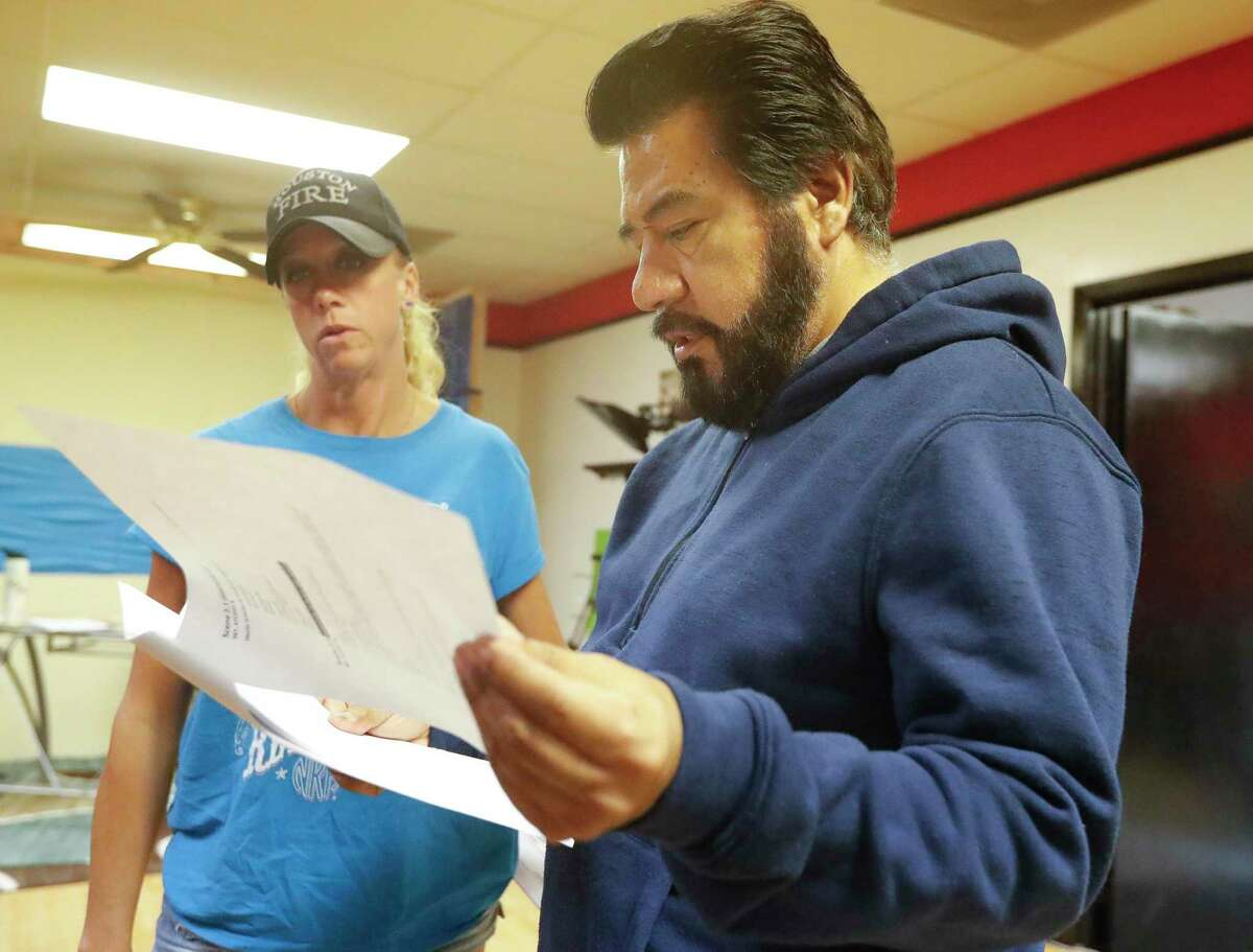 """Director Santiago Acosta reviews a script as film students finish filming on their first film """"Escape from Film School"""" at the Indie Film Foundation Studio, Saturday, July 31, 2021, in Conroe. The film premiers at 4 p.m. Saturday at Star Cinema Grill in Conroe."""