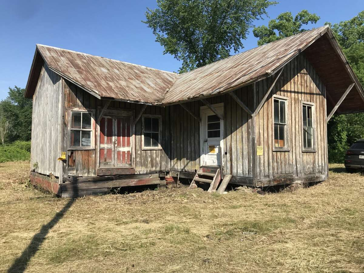 """The 1876 train depot that Kate Wood is rehabilitating in Copake. The real estate broker and historic house rehabber says she has seen a lot of competitive bidding on 19th-century farmhouses - """"especially if there's a barn."""""""