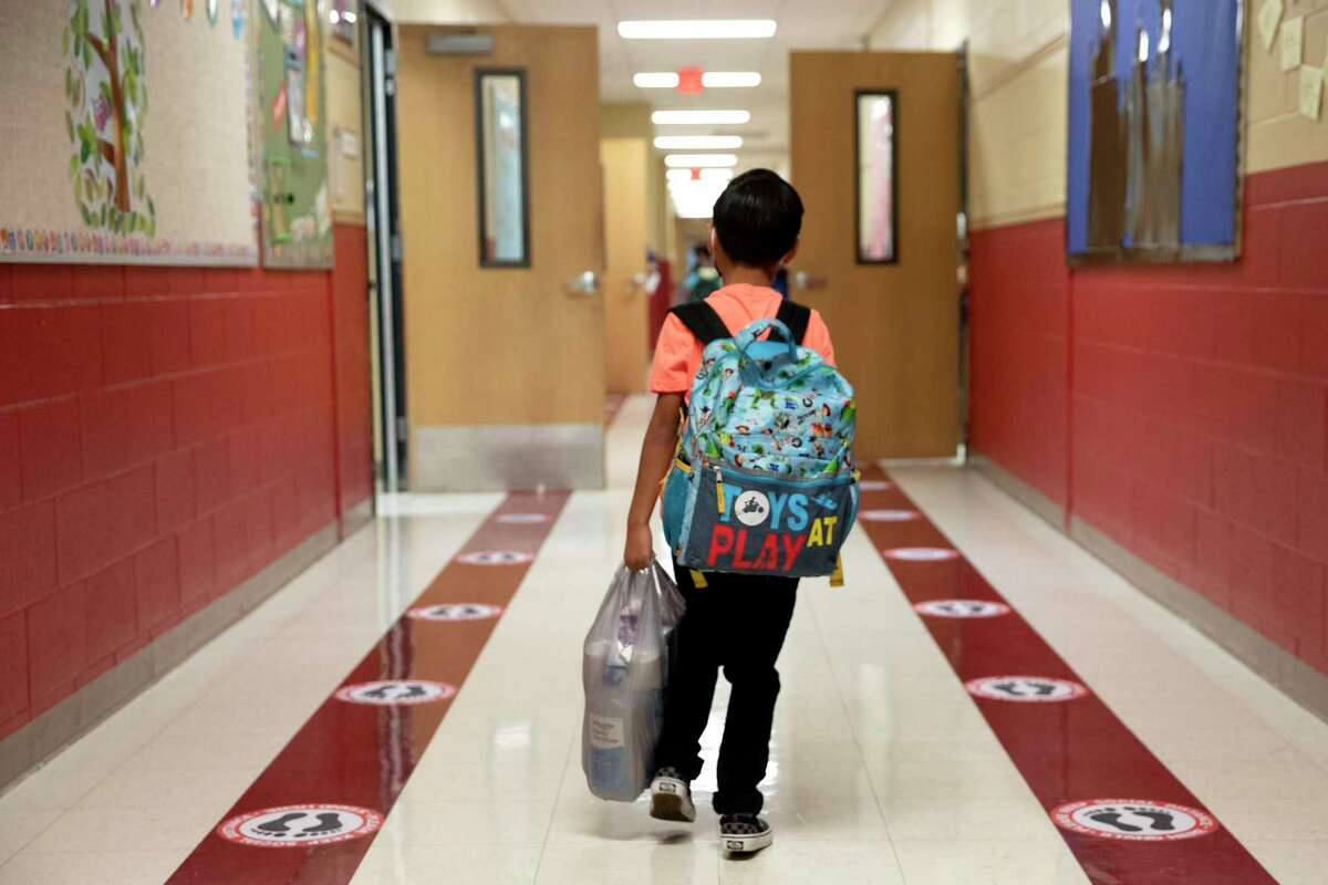 A student walks through the hallway to his classroom on the first day of school at Pearce Elementary in Southside ISD.