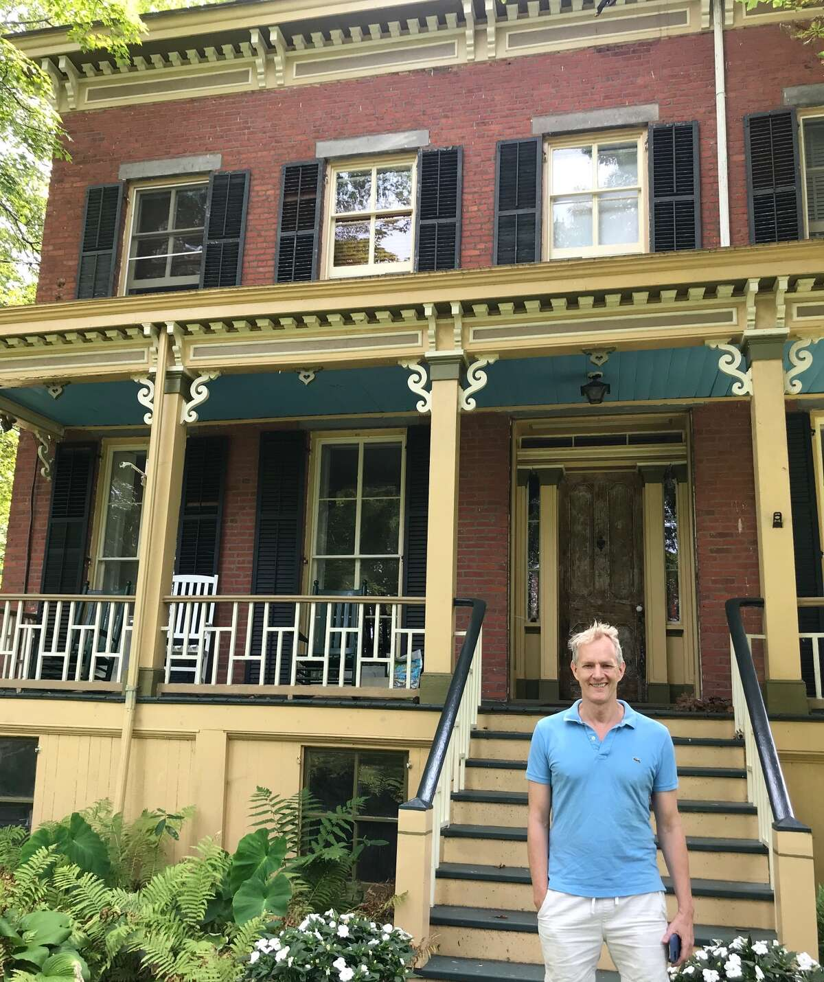 Conrad Hanson-Kelly outside of the 1850s brick house he rehabbed in Germantown.
